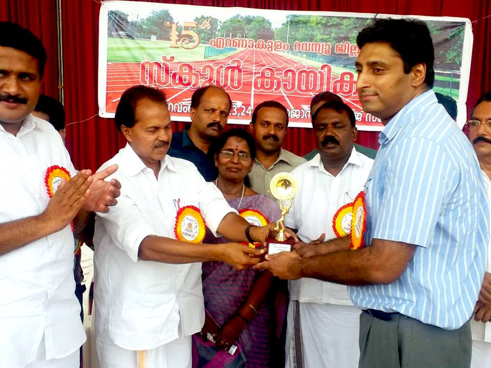 Receives a memento from Sri. P.T. Thomas M.L.A.